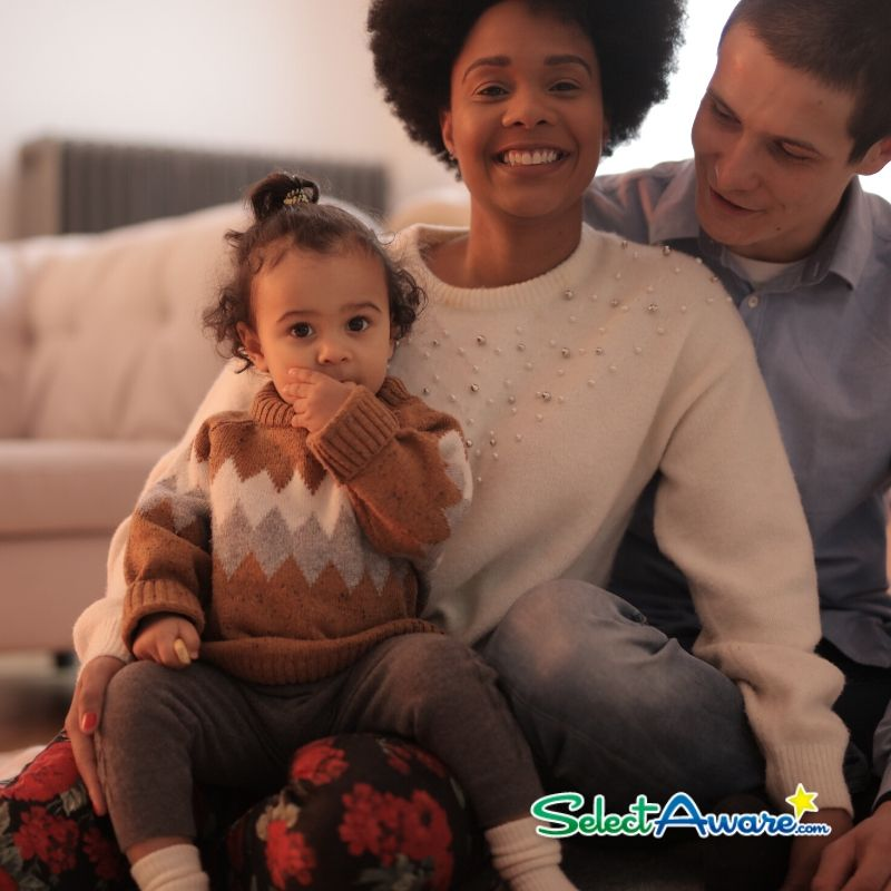 Smiling Family with little girl