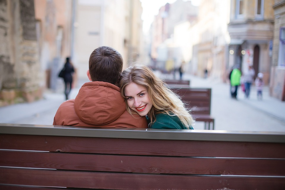 Couple relaxing on bench