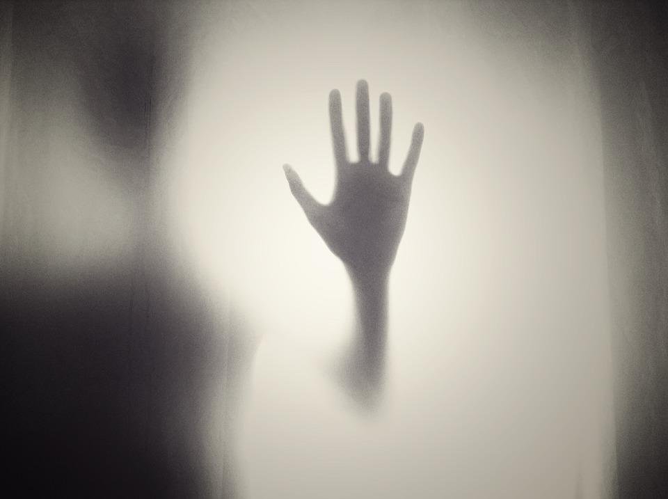Alien hand on window