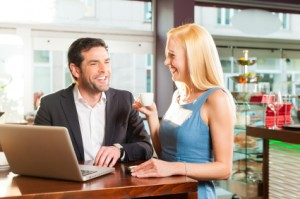 Man and woman talking over business